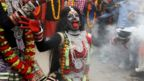 A person dressed as Hindu goddess Kali performs a dance during a religious procession during the Maha Shivratri festival in Allahabad, India