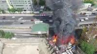 A pylon on fire in the Philippines.
