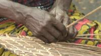 Woman's hands weaving